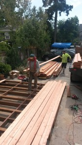 Placing the boards on the deck frame.